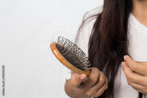 young woman worried about hair loss on a white background Canvas Print