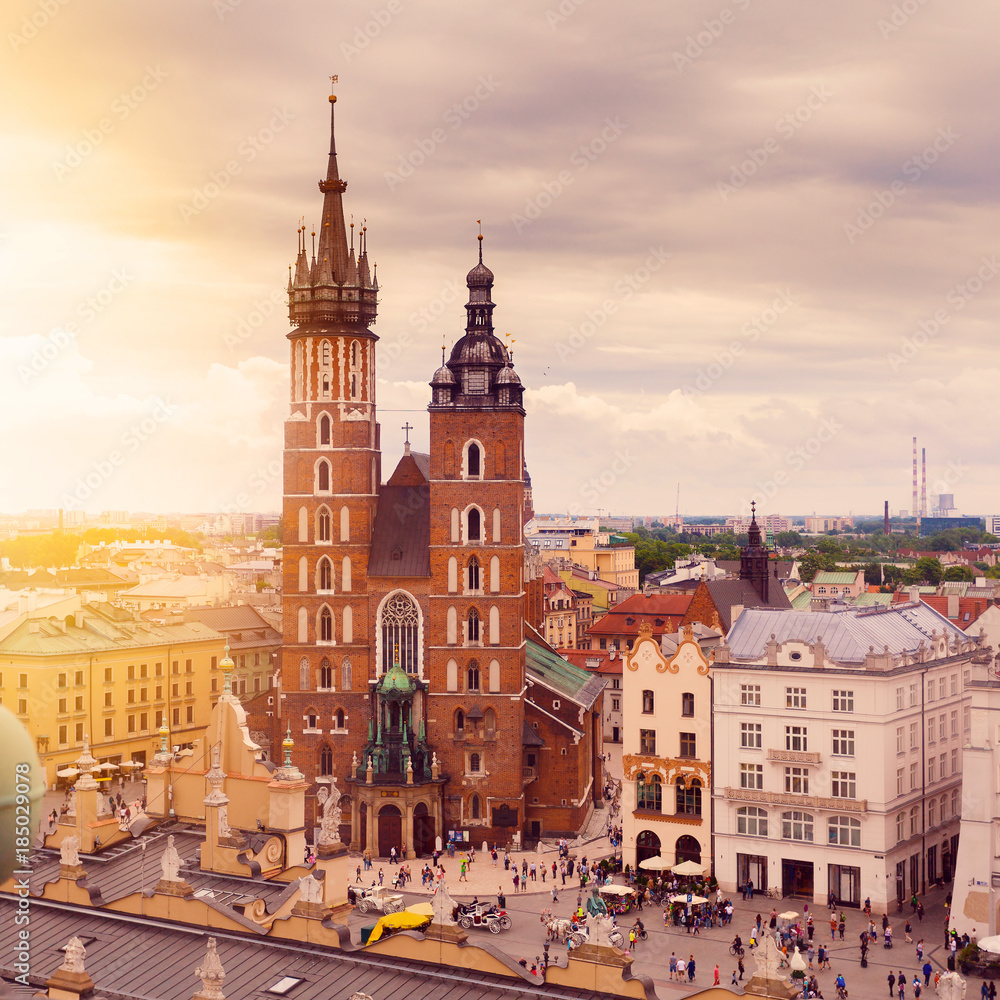 Fototapety, obrazy: Church of St. Mary in the main Market Square on the background of dramatic sky. Basilica Mariacka. Krakow. Poland.
