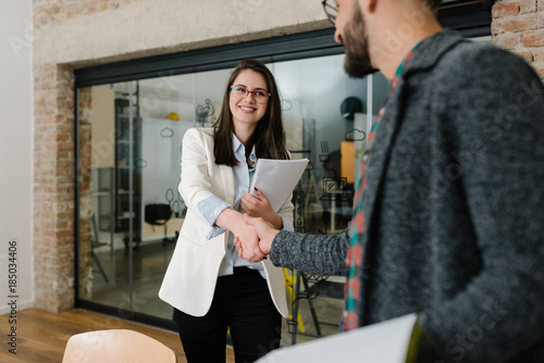 Firm handshake and approval smile