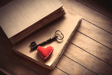 Vintage Key With Heart Shape And Old Books