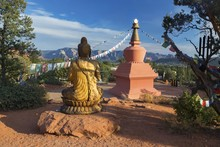 Amitabha Stupa, Buddha Statue And Prayer Flags With Distant Red Rock Landscape In Peace Park, Sedona Arizona