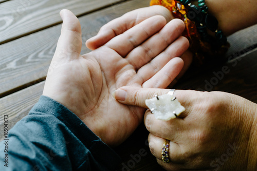 Top view of human hand and psychic or fortune teller explains lines on palm Canvas Print