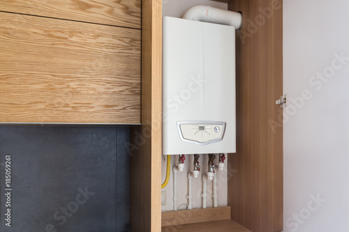 Opened kitchen cabinet and a gas boiler, a smart solution to hide ...