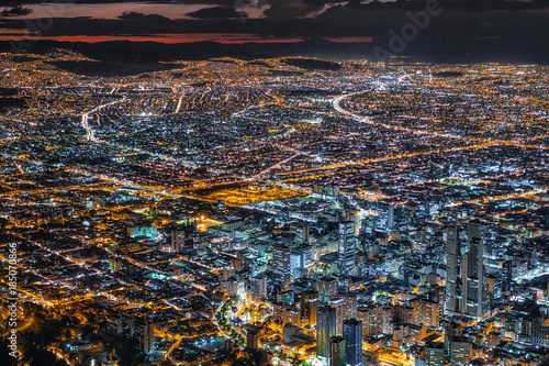 Photo Stands South America Country Bogota, Colombia, view of downtown buildings and cityscape illuminated at dusk.