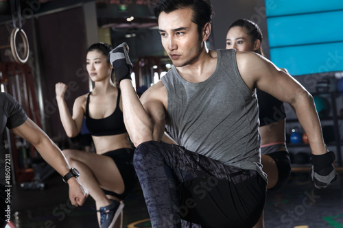 Deurstickers Peking Young people exercise at the gym