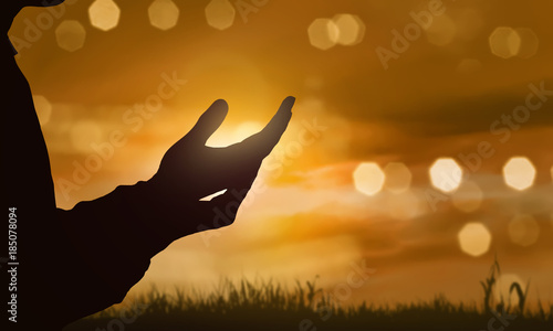 Silhouette of human hand with open palm praying to god Fototapete