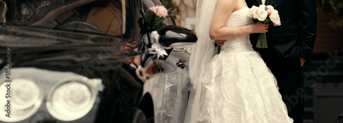 bride and groom by the car background