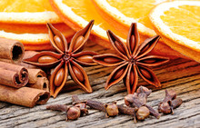 Anise Star With Clove Cinnamon Sticks And Slice Of Dried Orange On Table