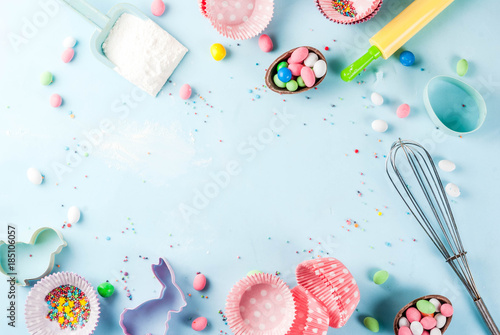 Sweet baking concept for Easter,  cooking background with baking - with a rolling pin, whisk for whipping, cookie cutters, sugar sprinkling, flour Canvas Print