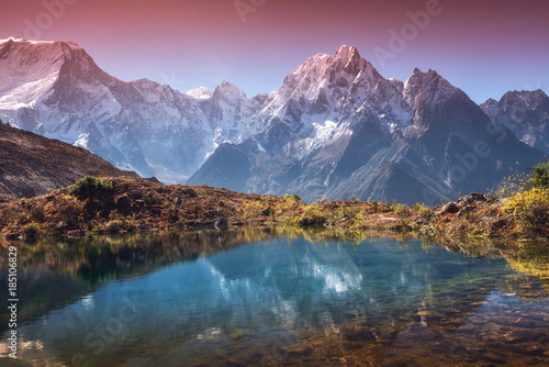 Foto auf Gartenposter Reflexion Beautiful landscape with high mountains with snow covered peaks, sky reflected in lake. Mountain valley with reflection in water in sunrise. Nepal. Amazing scene with Himalayan mountains. Nature