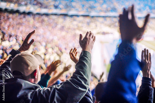 Football fans clapping on the podium of the stadium Canvas-taulu