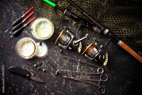 Foto op Aluminium Accessories for sport fishing on the old background