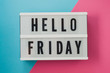 canvas print picture - Hello Friday- text on a display on blue and pink bright background.