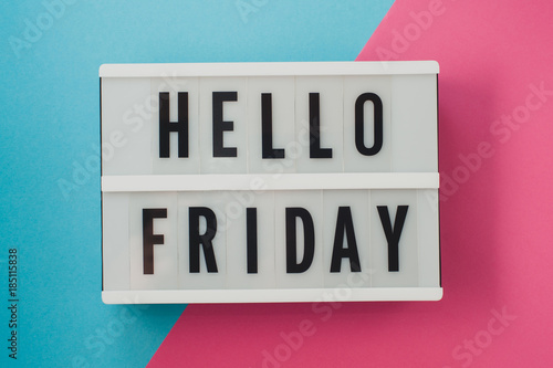 Fotografia  Hello Friday- text on a display on blue and pink bright background