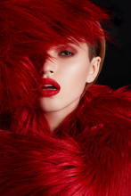 Beautiful Woman With Red Lips In Luxury Red Fur Coat. Beauty Fashion Model Girl Portrait With Professional Makeup And Clear Skin. Beautiful Glamour Luxury Winter Lady.