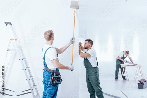 Home renovation crew finishing interior