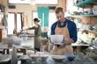 Male potter checking ceramic bowl