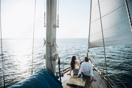 Fényképezés  Young beautiful couple swim on the sea on a yacht