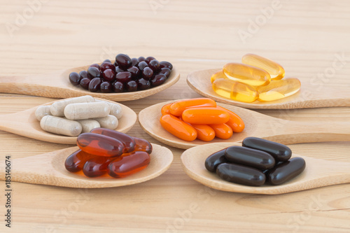 Fotografie, Obraz  Healthy Vitamin supplement capsules in a spoons.