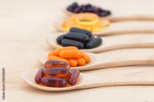 Fototapeta Healthy Vitamin supplement capsules in a spoons.