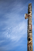 Low Angle View Of Totem Pole A...