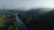 Aerial View. Flying over the high mountains in beautiful clouds . Aerial camera shot. Air clouds