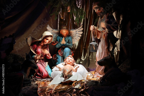 Christmas crib, biblical scene Birth of Jesus Christ in Bethlehem Fototapet