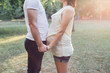 Pregnant couple holding hands