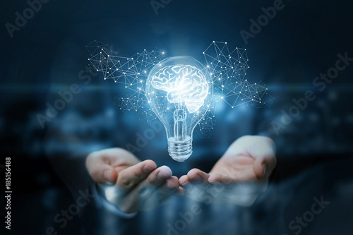Light bulb with brain inside the hands of the businessman. Canvas Print