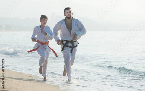 Garden Poster Martial arts Man and boy exercising karate