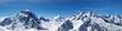canvas print picture - Panoramic view of snow-capped mountain peaks