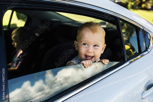Baby girl looking through car window