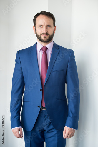 Fototapety, obrazy: Man with beard in blue formal suit