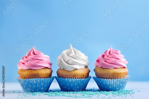 Fotografie, Obraz  Delicious cupcakes on color background