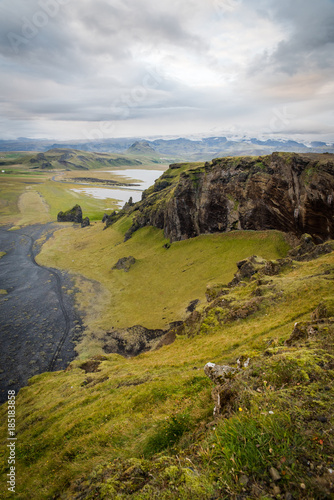 Poster Donkergrijs Scenic, landscape view of mountains, glaciers, lakes, and a beach in Iceland.