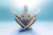 Man meditating under water