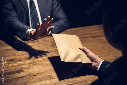 Valokuvatapetti Businessman rejecting money in the envelope