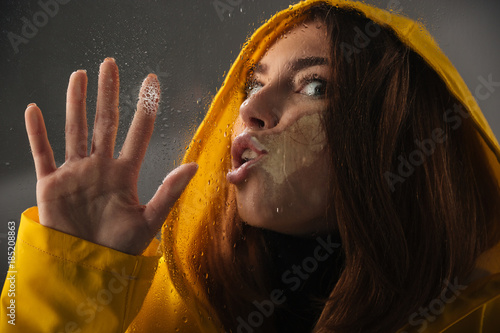 Fotografie, Obraz  Close up of a funny girl dressed in raincoat