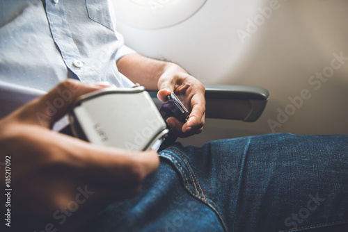 Passenger fastening seat belt while sitting on the airplane for safe flight Canvas Print