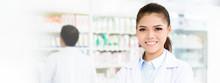 Smiling Asian Female Pharmacis...