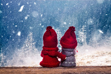 Boy And Girl Christmas Dolls In Winter Wonderland Watching Snowy Fir Trees In The Mountains
