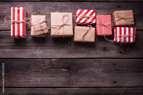 Border from gift boxes with presents on vintage wooden background.