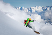 A Male Skier Skiing In Powder ...