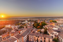 Aerial View Of Segovia At Sunset In Autonomous Region Of Castile And León, With Illuminated Buildings And Alcazar. Castle Residence Of Kings In Medieval Epoch,
