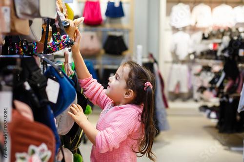 Fotografija  Adorable little girl choosing clothes