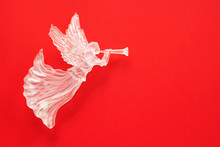Christmas Angel Figurine On Red Background.