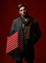 Man In Vintage Style With Present. Guy With Brutal Face