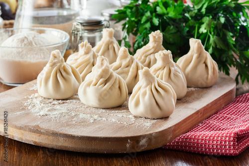 Raw Georgian dumplings - Khinkali (Chinkali) with minced meat and herbs