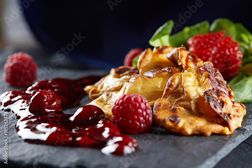 Grilled smoked cheese polish traditional oscypek with strawberry sauce , grilled cheese, barbecue, barbecue grill, strawberry , raspberry mousse, jam, marmalade