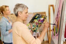Senior Woman Painting At Art S...